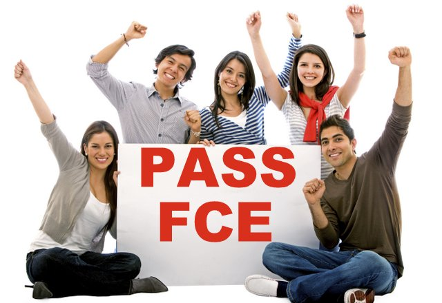 A small group of students with a plackard: Pass FCE