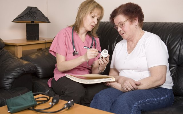 A healthcare worker with a patient